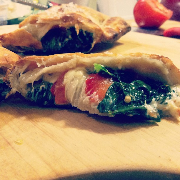 Cookbookin'! Fresh kale and tomato calzone.  (Taken with instagram)