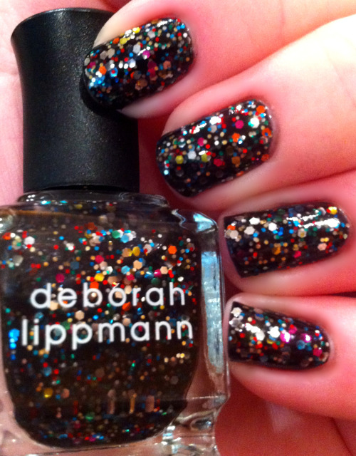 """Forget You"" by Deborah Lippman is a rainbow glitter in a black base. I put it over a coat of OPI ""Suzi Skis in the Pyrenees"", so it wasn't sheer."