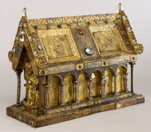"The Shrine of St. Amandus; The Walters Art Museum, Baltimore. Flemish, early 13th century with significant later additions. From Kathryn B. Gerry's article on the Treasures of Heaven exhibit:  Amandus was the bishop of Maastricht and the founder and abbot of the Monastery of Elnon, near Tournai, where he was buried after his death (ca. 679). Before the end of the seventh century, he was considered a saint, and a pilgrimage cult developed at Elnon, eventually requiring that his bones be housed in a reliquary that could be shown to the faithful. In addition to being visited by pilgrims and carried in procession on feast days, the relics of St. Amandus were taken on a tour of the region around Elnon at least twice: once in 1066 to raise funds to rebuild the monastery after it was destroyed by fire, and again in 1107 to remind ambitious nobles of the monastery's power and privileges. At least one earlier reliquary for St. Amandus must have existed, but it was destroyed or lost prior to the thirteenth century, perhaps in the fire of 1066. The figure at one of the gable-shaped ends is presumably Amandus; the other end, now empty, probably originally contained a figure of Christ. Although many such reliquaries were destroyed or sold to collectors during periods of religious reformation and political revolution, some continued to be used into the modern period: a reliquary similar to that of St. Amandus is still owned by the religious brotherhood of St. Symphorian in Belgium, and carried in public procession on several occasions during the year. Over the centuries, reliquaries such as this were likely to suffer some wear. Extensive scientific testing has shown that this reliquary was made in the early thirteenth century, but that it has been repaired and modified throughout the centuries as it continued to be used in the service of the cult of St. Amandus. The most recent modifications, however, were made by a late nineteenth- or early twentieth-century art dealer hoping to ""improve"" the piece and make it more marketable.  I'm an Amanda, so this appeals to me greatly. However, if I were a saint, I would have preferred the tour of Flanders before dying."