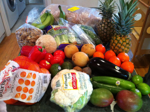 Bountiful Baskets food co-op for this week. Organic basket, tropical pack, tropical granola and organic omgea-3 multigrain bread.  In the picture: oranges, cauliflower, mangos, limes, zucchini, eggplant, kiwi, avocado, tomatoes, red bell pepper, coconut, Asian pears, tangerines, pineapples, mint, vanilla beans, romaine, tropical granola, bananas, plantain, bread.