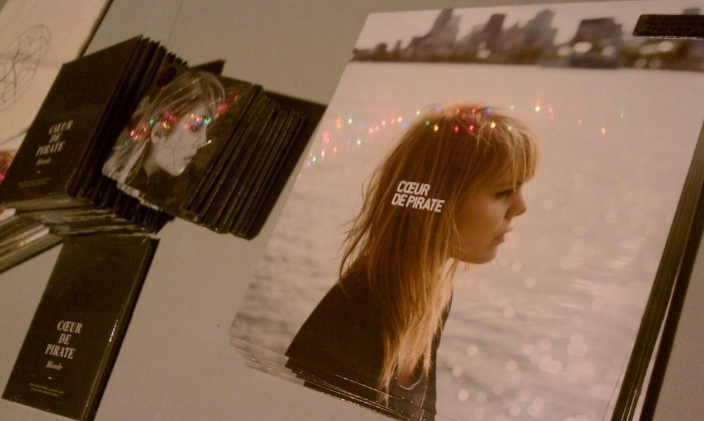 @BostonMerchGirl  Reflection of lights on @Coeur_de_Pirate merch