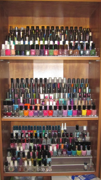 My nail polish collection as of today.  I just thought I'd snap a photo for you all.  I think I may have to clear out a shelf on my other book case and make another rack. Lol
