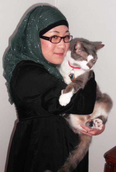 "Hijab Photo Competition (HPC) IIContestant #19: Nancy from Canada Reason for why your photo represents ""A True Hijabi"":It is difficult to define what the terms ""true hijabi"" means. It certainly does not matter if someone's hijab is leopard-print or black or polka dotted, it all comes down to the actual person and how they choose to portray and dress themselves."
