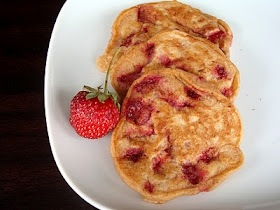 thewaytoaheart:  Strawberry Vanilla Pancakes Yields 32 small pancakes  1 1/4 cup whole wheat pastry flour (or all-purpose flour) 1 tablespoon brown sugar, packed 2 teaspoons baking powder 1/4 teaspoon salt (optional) 1 cup buttermilk 1 egg 1 tablespoon canola oil 2 tablespoons vanilla extract 2 cups strawberries, diced or sliced 1-2 teaspoons granulated sugar zest of 1 orange (optional) powdered sugar or maple syrup, for serving (optional)  In a small bowl, mix strawberries and orange zest (if using) with 1-2 teaspoons of granulated sugar (adjust the sugar based on the sweetness of your berries).   In a large bowl, whisk together flour, brown sugar and baking powder.  Set aside.  In a medium bowl, whisk buttermilk, egg, oil and vanilla until combined. Add wet ingredients to dry ingredients, mixing until combined.  Fold in strawberries and orange zest, if using. Heat griddle to medium heat (add oil and/or use cooking spray as needed).  Pour about 1 tablespoon of batter onto griddle for each pancake.  Cook until you see bubbles appear (about 2-3 minutes), flip and cook on the other side until set (about 2 minutes).