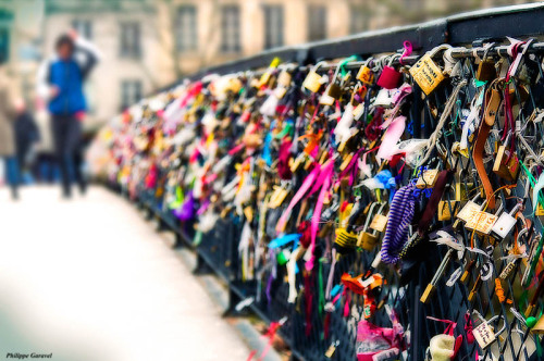 Lovers Bridge in Paris, Couples go there together and put a padlock on bridge then through the key in the river to symbolize Eternal Love <3