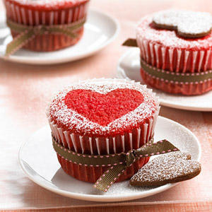 Red sponge cupcakes topped with heart biscuits.