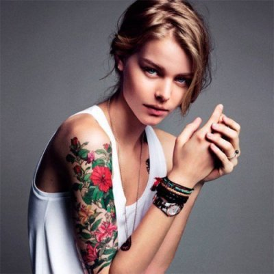 The girl with the flower tattoo.