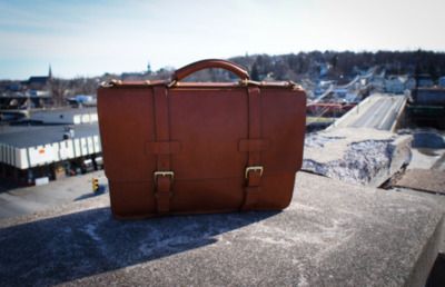 Frank Clegg Leatherworks - The American Briefcase This slightly wedge shaped briefcase has a more contemporary feel than the English Brief. With its more angular features, it evokes a more edgy style which will surely please those who like to mix both modern and classic. All the products are made in my Fall River, Massachusetts workshop by a team who share the pride of these quality products.