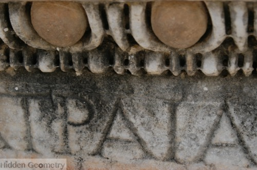 Part of emperor Trajan's name on a column in Ephesus, Turkey