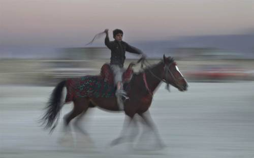 landofthelions:  A young Afghan boy, who earns his living by hiring his horse, rides through Kabul.