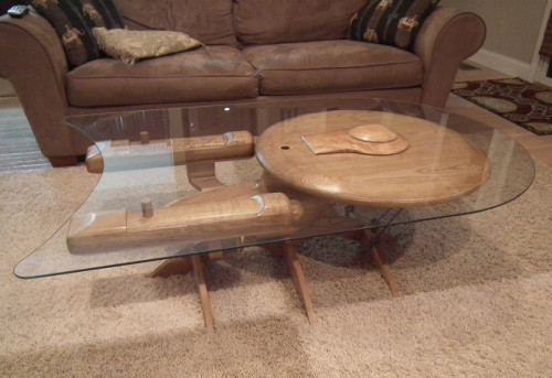 Beam me up, coffee table: More exciting than a J.J. Abrams reboot In case you're tired of hearing about people dying in Syria, here's a picture of a coffee table that looks like the Starship Enterprise. It can be yours for a mere $3,100. [h/t Geekologie] source EDIT: Yes we were trolling. Sorry, all. :P Follow ShortFormBlog