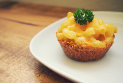 Ummm, yes. hrrrthrrr:  Mini Mac and Cheese Pies (makes 8) Ingredients 1 1/2 cups Ritz crackers, crushed (I threw mine in a food processor) 2 cups white cheddar cheese, grated and divided 4 tablespoons unsalted butter, melted 4 1/2 cups cooked elbow macaroni (about 8 ounces uncooked) One 5.2-ounce container of Boursin Garlic and Herb cheese 2 tablespoons unsalted butter, cold 2 large eggs 1/2 cup milk 1/4 cup sour cream 1/4 teaspoon salt Parsley, for garnish, optional Directions Preheat the oven to 350 degrees. Generously spray 8 cups of your muffin pan with cooking spray. In a large bowl, combine the crushed Ritz crackers, 1 cup of the shredded white cheddar cheese, and the melted butter, mixing well until the mixture holds together and resembles coarse sand. Divide the mixture among the 8 muffin cups and, using your fingers or the back of a spoon, firmly press the crust into the bottoms and up the sides of each muffin cup. In another large bowl, combine the cooked (and still hot!) macaroni with 1/2 cup of the shredded white cheddar, the Boursin cheese, and the butter, mixing well. In a small bowl, combine the eggs, milk, sour cream, salt, and red pepper flakes, mixing well.  Add the egg/milk mixture to the cooked macaroni, mixing until all the ingredients are melted and smooth. Place about 2-3 tablespoons of the macaroni mixture into each muffin cup (you will probably have a little leftover macaroni). Top each muffin cup with the remaining white cheddar.  Bake the mac and cheese pies until lightly golden on top, about 20-25 minutes. Let cool slightly before removing from the muffin pan, garnish with parsley, and serve immediately.