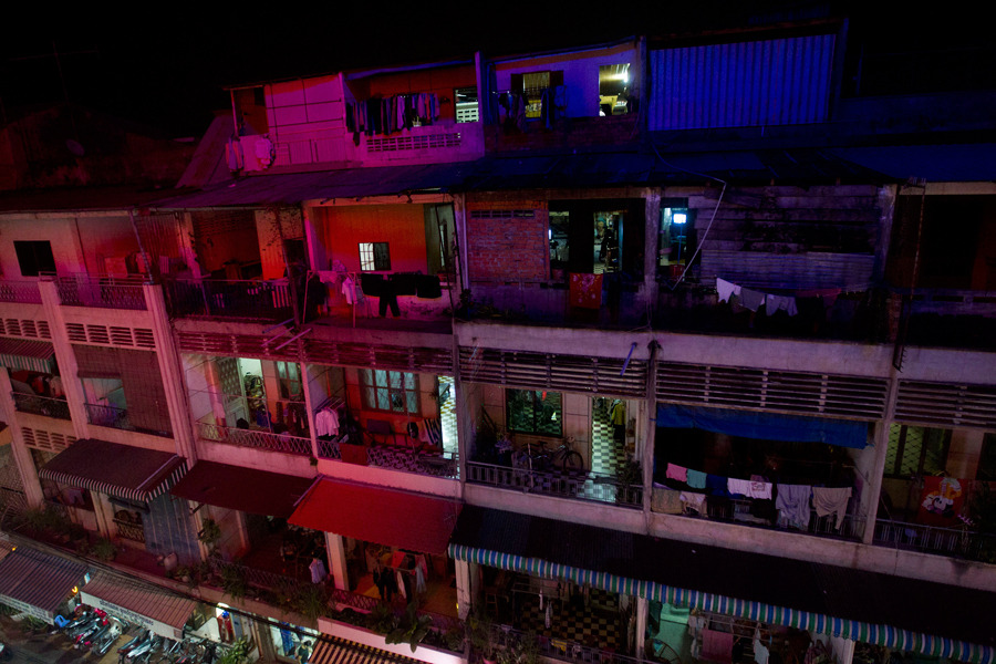 Lights illuminate the facade of a residential building in Phnom Penh, Cambodia, on Monday, Jan. 16. Photograph by Brent Lewin/Bloomberg