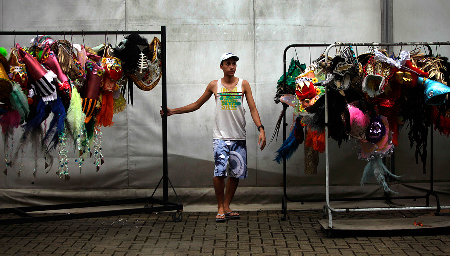 A worker pulls racks of costumes at the Cidade do Samba factory shed in Rio de Janeiro, Brazil, on Thursday, Jan. 19. Photograph by Dado Galdieri/Bloomberg