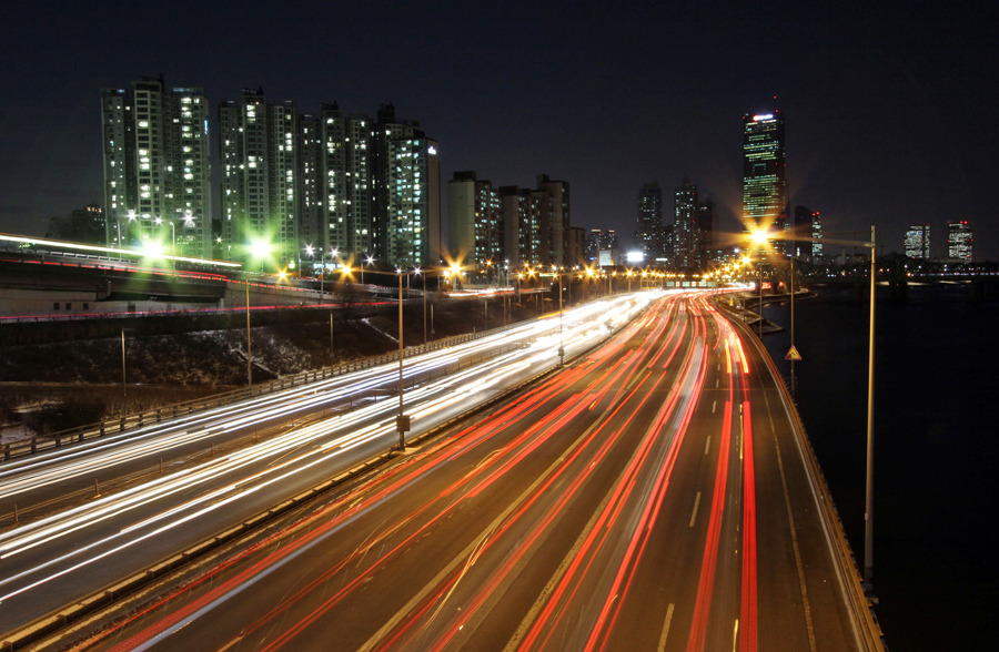 Traffic moves along the Olympic Highway at night in Seoul, South Korea, on Wednesday, Jan. 25. Photograph by Chiho Jeong/Bloomberg