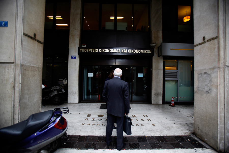 A pedestrian is seen outside an entrance to the Greek finance ministry in Athens, Greece, on Tuesday, Jan. 24. Photograph by Kostas Tsironis/Bloomberg