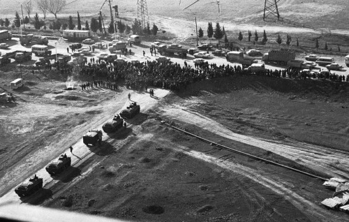 A crowd blocks the passage of Soviet tanks on a road near Ganja, formerly Kirovabad, in Soviet Azerbaijan, on January 22, 1990. Troops sent into the area last week to quell ethnic violence met both armed and peaceful resistance.