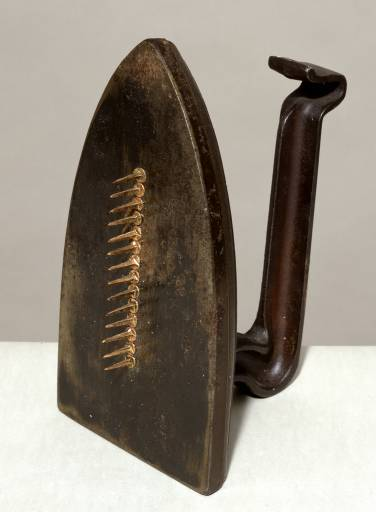 Man Ray, Cadeau (Gift), 1921, editioned replica 1972, iron and nails.  Presented at the Tate, London; © Man Ray Trust/ADAGP, Paris and DACS, London 2002