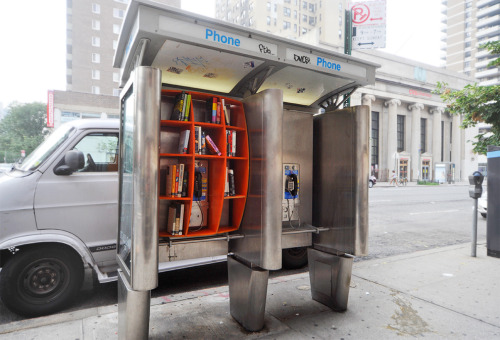 urbanbricolage:  How to start book sharing in public space? Cool way to reuse obsolete phone booths…