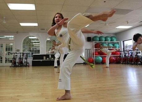 "Brazilian martial art becomes a hot exercise - ""Dance & Fight Cultural Center"" promises the sign outside Marcus Coreba's capoeira studio in Marlborough. Capoeira, a beautiful, lethal blend of music, dance, and martial art, is part of the American Dream - the South American Dream."