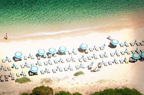 Umbrellas on a beach in Sardinia, Italy 2010 via PhotoToaster, using these settings.