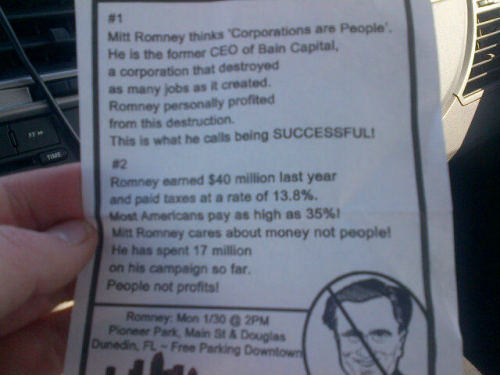 "A flyer handed out by ""Occupy kids"" at a Romney event in Florida. Photo by Brian Braiker of the Guardian, who suspects those handing them out might be ""Newt moles."""