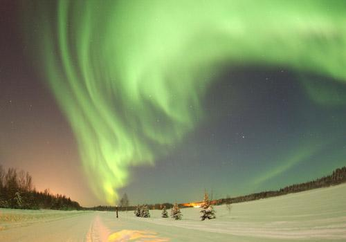 "As solar storms barraged the Earth last week, a photographer caught this amazing, real-time video of northern lights over Norway. Check it out.  ""The movement you're seeing isn't a physical motion. It's not like solid curtains of material are flapping. The lights are caused by atoms in the upper atmosphere getting hit by subatomic particles blasted out by the Sun, caught by our Earth's magnetic field, and funneled down into our air. These particles dump energy into the atoms, moving the electrons up in energy (called excitation). The electrons then jump back down, emitting light in the process (de-excitation)."""