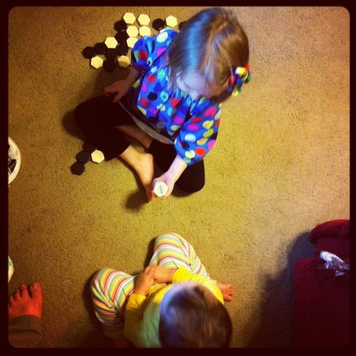 Yeah, that's my 4yo teaching my 2yo Hive… Start 'em young… #boardgame  (Taken with instagram)