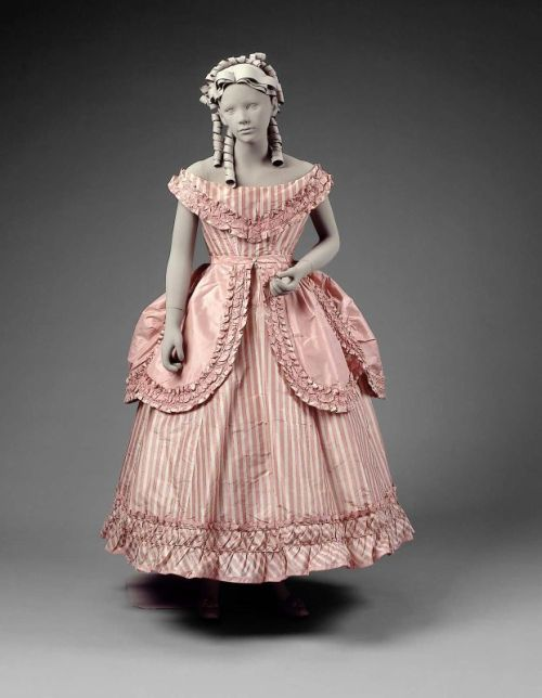 An absolutely gorgeous girl's party dress dating from between 1865 and 1870.