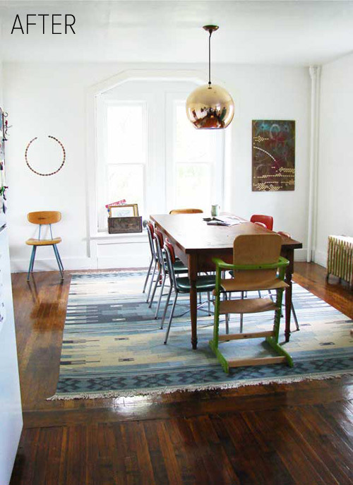 I love quite a bit about this room: The balance of the original wood floors and the brassiness of the large globe pendant light.  The mix of school room/industrial dining room chairs The rectangular painting opposite the almost-complete circle of (if I recall correctly) souvenir pennies The blanked out light explosion from the all-white windows with no window treatments