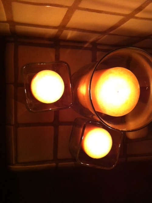 This is what $40 worth of cheap candles from Cost Plus looks like. Normally I'm not a cheap scented candle PERSON, but I'll tell you what, 9 days of dead-rodent-in-your-house will turn you — will turn anyone, really — into a fan of cheap scented candles. This is a last resort. Previously, I have tried: baking soda diluted peppermint oil sprayed liberally along the floorboards a lot of lilies complaining whining crying a very small expensive citrus-scented candle from The Whole These things were all powerless against the scent of rat-rot. Time to bring out the big guns.