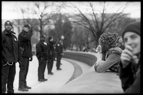 "occupysdphotography: Occupy Congress | Capitol Police Line on Flickr. Via Flickr: The permit only allowed protesters to be on the lawn area of the Capitol on January 17, 2012 for the National Action calling all occupations to ""Occupy Congress"" even though the steps of Congress are considered ""public."" Any attempt to go forth was met with police action including arrest. Pictured here is a woman glaring in the direction of the Capitol Police showing no signs of being intimidated by the police line. (Johnny Nguyen)  Gorgeous photography by #occupySD activist Johnny Nguyen while at #OccupyCongress #J17"