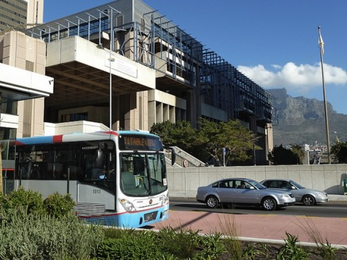 thisbigcity:  Is this the world's newest Bus Rapid Transit system? Opened in May 2011, Cape Town is hoping to transform public transport. More on This Big City. 這是全球最新的公車捷運系統嗎?南非開普敦的系統於2011年5月啟用,希望改善大眾運輸。全文請見《城事》。  This summer I used the BRT system in Bogota. It was so easy to use and convenient. The fact that I rarely needed to wait more than a few minutes for a bus made all the difference. Missing your bus and then having to wait 30-40 minutes for the next one sucks and makes it hard to recruit new riders. I hope that Cape Town continues to build its capacity so that it can become a model for other African cities.