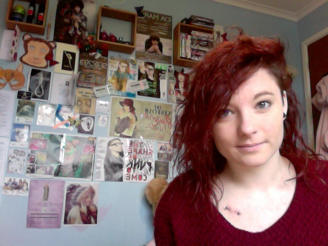 racheltwelftree:  O how vain …Me today & My Awesome Wall..Yes I do Love skrillex as you can see on my wall as well as all the other bands and bits & bobs   Possibly the most angry surface piercing I've seen in a while. I'd really recommend taking that out ASAP, otherwise you'll be left with a load of deep scar tissue, and a nasty scar to boot!  If anyone ever sees the red lines of doom on a surface piercing, it needs to be out ASAP! The sooner you get it out, the less scarring, the more pliable the tissue, and the more likely you are to be able to get pierced within a similar location. -E