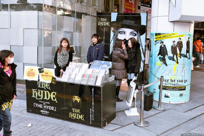 "The Hyde x 2AM in Shibuya by tokyofashion on Flickr.A book release event for J-Rock artist Hyde's new biography ""The Hyde"" next to a billboard for the K-Pop group 2AM. Seen today in Shibuya."