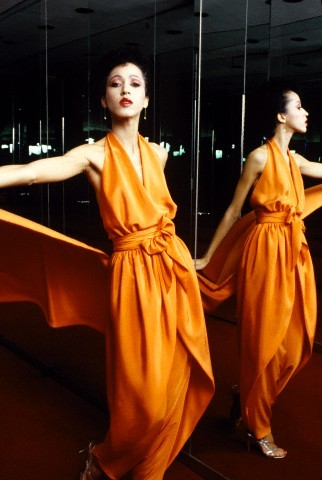 vintageblackglamour:  Pat Cleveland in an orange halter dress and pants ensemble from Halston's Spring 1980 collection. New York Fashion Week is next week and I'll be there again covering for my fashion/beauty blog 55 Secret Street. I hope I run into Pat again like I did last year! Photo by Dustin Pittman from the Conde Nast Archives.