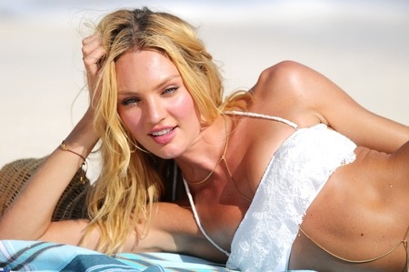 fox411:  How did you spend your Monday? Supermodel Candice Swanepoel spent it on the beach in St. Barts modeling bikinis. So she wins, but so do we, too. Check out her photo shoot — and more Victoria's Secret models on the beach — at x17Online.com.