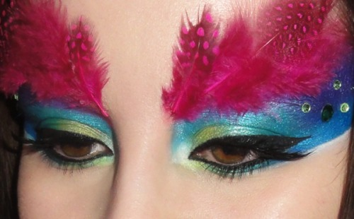 Watch this tutorial from Beautylish Beauty Doda K. to create your own feather mask makeup look!