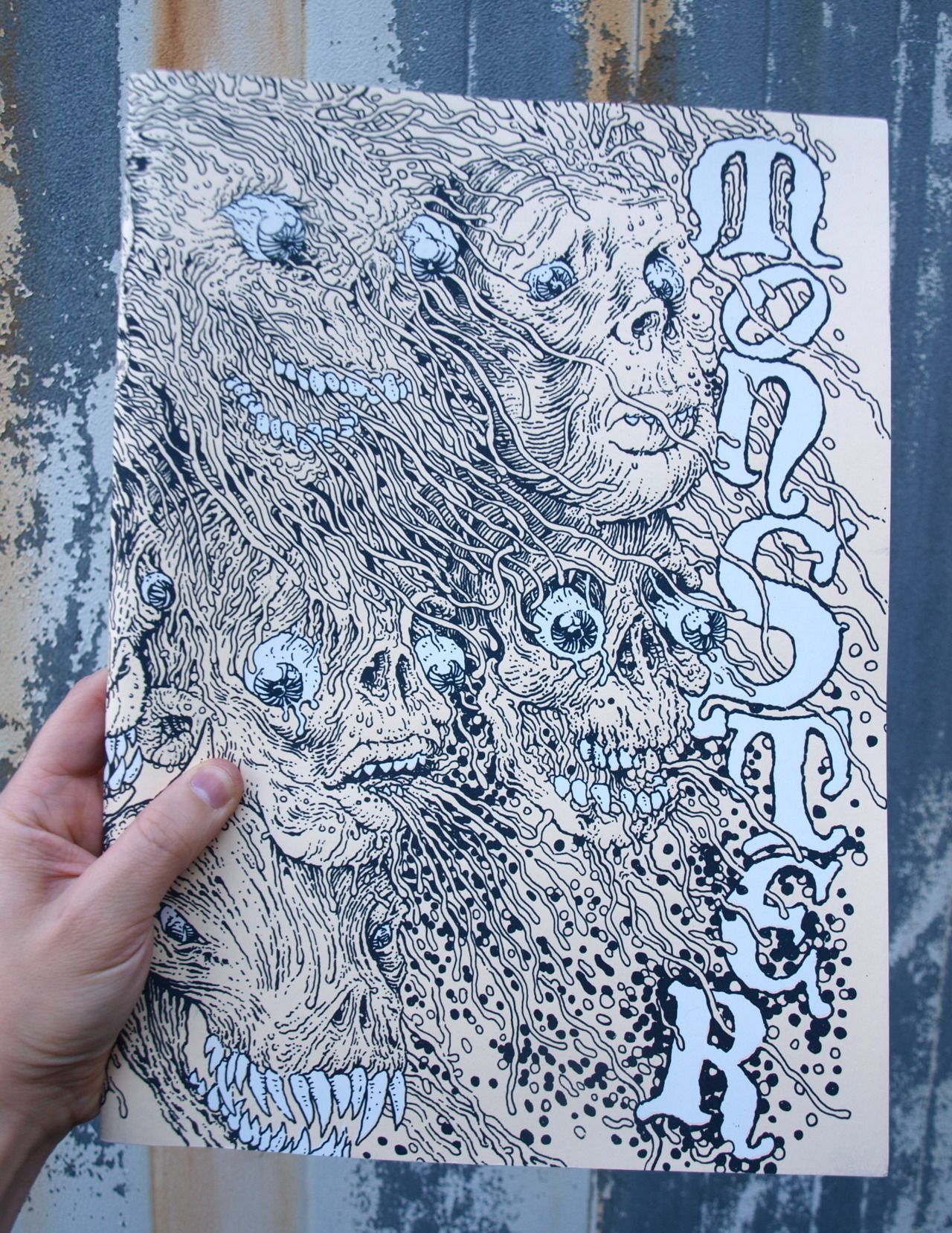 Monster: Comic anthology edited and published by Paul Lyons, in stock now at Chapel Hill Comics! Cover silkscreen by Paul Lyons. This thing is huge; see man hand for scale! Featuring art by Michael DeForge, Brian Ralph, James Kochalka, Jim Rugg, Brian Chippendale, and many more! Adults only.
