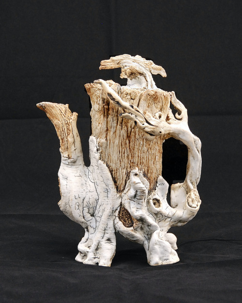 "David Gilbaugh: Racemosa, 2011, sculpted teapot, 4""(W) x 11""(H) x 8""(D), hand-built slab, B-mix stoneware paper clay with grog, cone 10 reduction, black stain brushed in crevices, water washed iron and rutile stainPermanent collection of the American Museum of Ceramic Arts"