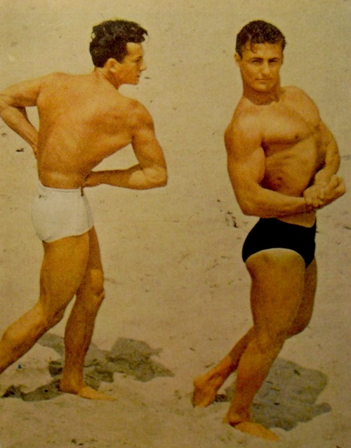 muscle men on beach in swim trunks bodybuilding (1950) #1