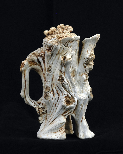 "David Gilbaugh: Sycamore Teappot #3, 2011, sculpted teapot, 11""(H) x 8""(D), hand-built slab, B-mix stoneware paper clay with grog, cone 10 reduction, black stain brushed in crevices, water washed iron and rutile stain over porcelain decorating slip"