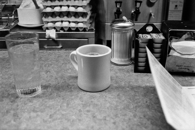 it's the simple things (roll-a-week 3/52) on Flickr.Sometimes all it takes to make a good night great is a cup of coffee and a stack of pancakes (they were cooking when I took this shot and when they were done I didn't have a chance to take a picture as I was too busy scarfing down the gloriousness that is the diner pancake. Hence its absence in the picture, but mention in the description) at the famous greasy spoon Mickey's Diner in St. Paul.