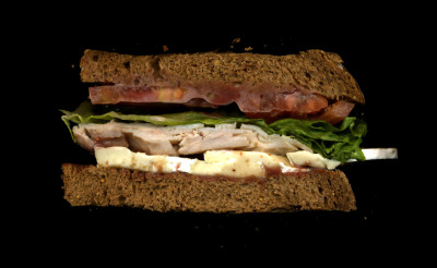 The Grey Dog: Turkey, Brie, Tomato, Lettuce, Raspberry Mustard, On Multi-Grain Bread.