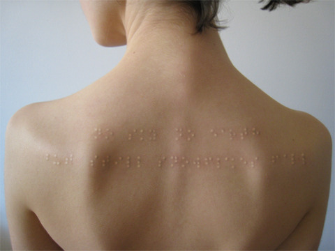 "Braille subdermal implants.  Directly translates to, ""No sky no earth but still snowflakes fall""   Wow"