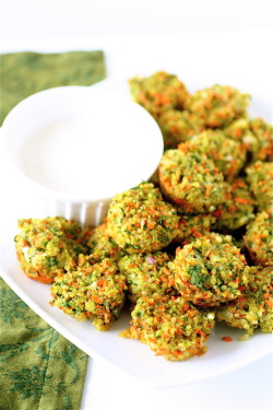 fithealthyandhappy:  Cheese and Vegetable Quinoa Bites Servings: 24 bites Ingredients 2 cups cooked quinoa 2 large eggs 3 carrots, shredded 1 and 1/2 cups fresh spinach, chopped 1 medium shallot, chopped 2 teaspoons garlic 4 ounces sharp cheddar cheese, grated 2 tablespoons flour Sea salt and pepper, to taste Instructions 1. Preheat the oven to 350 degrees. 2. Lightly spray a mini muffin pan with cooking spray. 3. In a large bowl, combine all of the ingredients together, mixing until thoroughly combined. 4. Using a melon baller or a tablespoon, place rounded drops of the mixture into each cup of the muffin pan, pressing each one down lightly with your fingers to make sure that each one is firmly packed. 5. Bake until lightly golden, about 15-20 minutes. 6. Serve immediately.