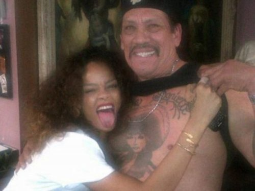 Rihanna Gets Overly Friendly with Danny Trejo's Chest Tattoo That ink woman is old enough to be her mother.