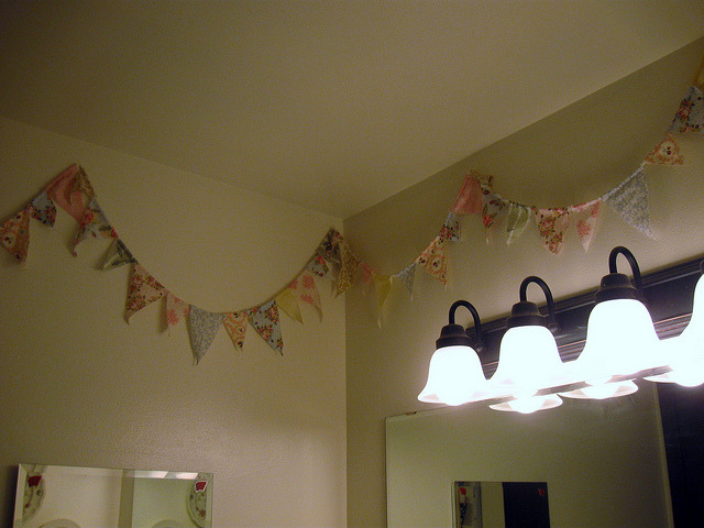 bathroom 3 on Flickr.Via Flickr: I made this bunting as a decoration for my bridal shower last year. It was definitely a labor of love (it ended up being about 100 feet long) so I needed to put it up somewhere. My girly bathroom seemed the best fit, that way my husband doesn't have to see it all the time.