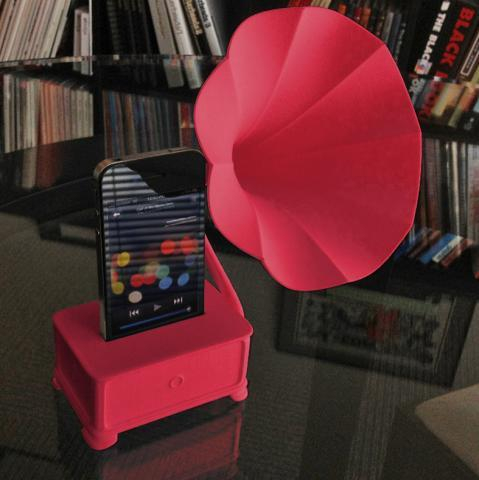 shapeways:  Schreer Design has created an analog amplifier for the iPhone called the iVictrola Gramophone, based on the old Gramophones of the late 19th and 20th centuries. The amplifier comes in two parts, including a sound magnifier and horn, which is adjustable up and down.  The best part? This is 3D printed. (via)