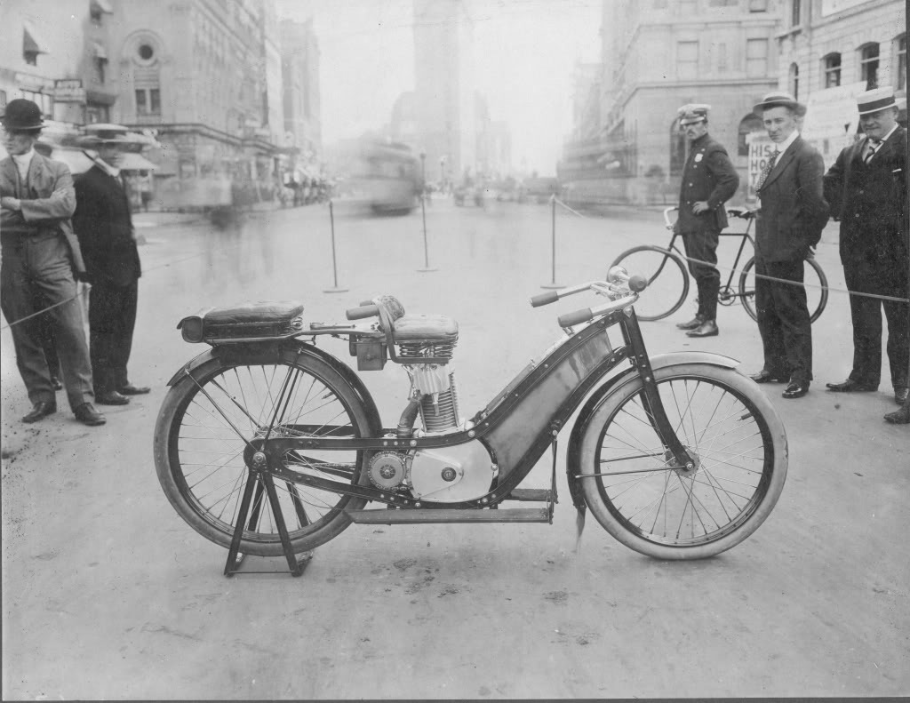 First NYPD Motorcycle early 1900's. Notice the Flatiron building in the background which is on 23rd Street/5th Avenue in NYC.